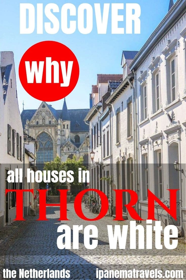 a cobblestone street with white hoses on both sides and overlay text: Discover why all houses in Thorn are white
