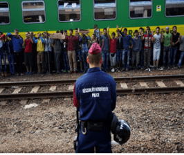 Syrian refugees outside Hungarian train station