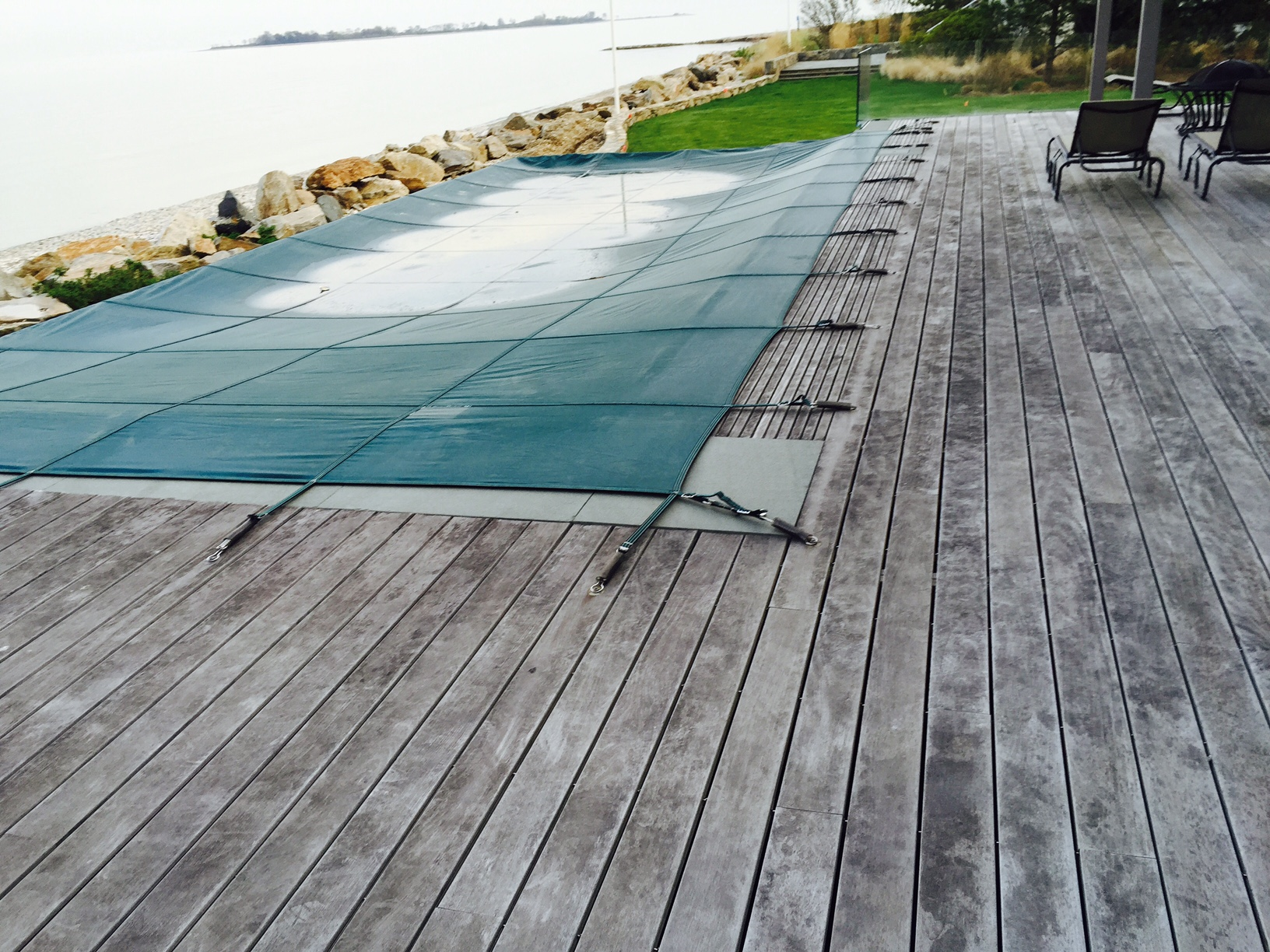 Weathered ipe deck by the ocean.