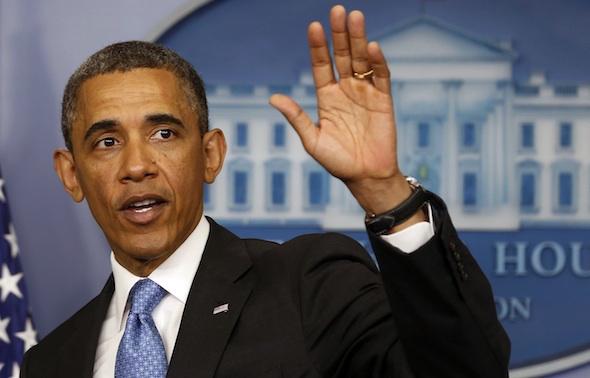 U.S. President Barack Obama waves after speaking at the White House in Washington