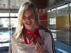 Katrin mit ihren drei olympischen Medallien