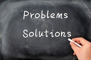 12825194-problems-and-solutions-written-on-a-blackboard-background