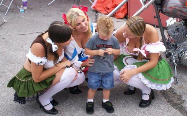 Kid with hot Octoberfest Girls
