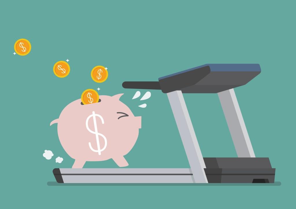 Piggy bank running on a treadmill. Business concept