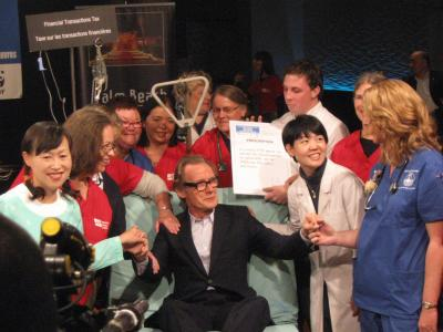Nurses check up on Bill Nighy after his endorsement of the Robin Hood Tax. Photo by Sarah Anderson.