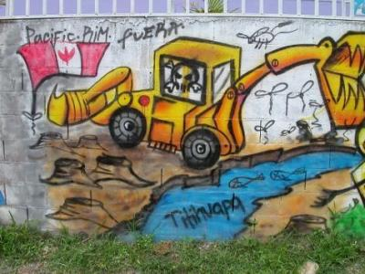 A mural in El Salvador shows Pacific Rim as a river-killing monster.