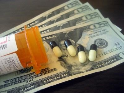 Bottle of pills over twenty dollar bills