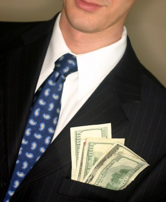Businessman with cash in his pocket