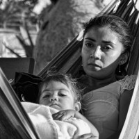 mother contemplative with child in hammock