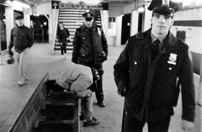 Policemen and bystander