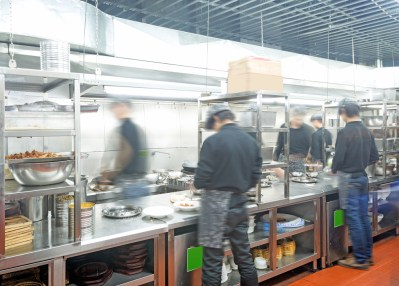 Restaurant workers in a busy kitchen