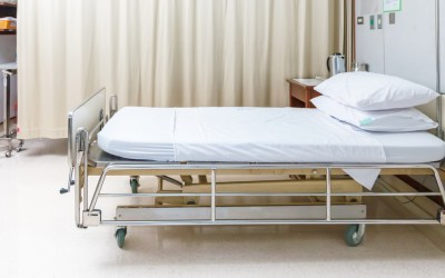 an empty hospital bed as a metaphor for the inequality in our healthcare system during the coronavirus
