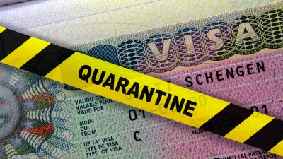A passport with a quarantine sticker on it