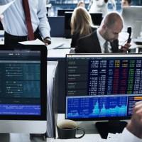 People working in stock market exchange