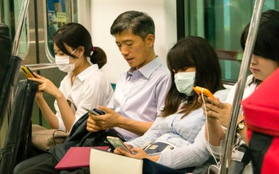 people sitting on a train during the coronavirus