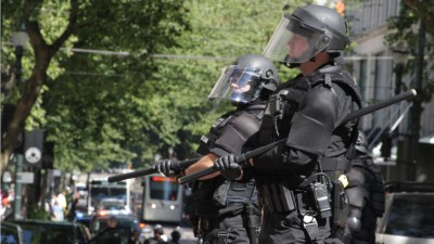 police stand in militarized riot gear