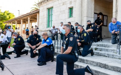 Coral Gables, Florida - May 30, 2020- Police kneeling along side out of view protesters during protest for George Floyd