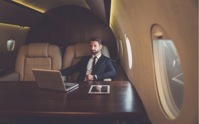 Business man flying on a private jet