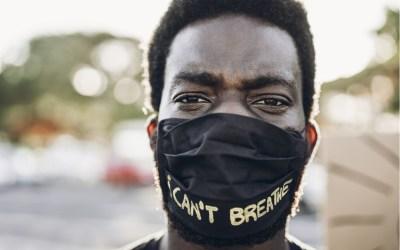 man wearing i cant breathe mask