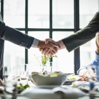 tax - corporations - Business People Shaking Hands