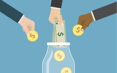 billionaire charity - hands putting money in a jar