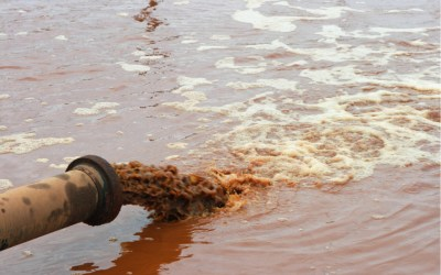 dirty water discharged into a river to depict environmental racism