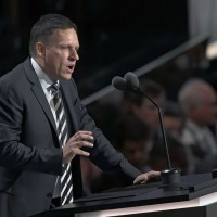 paypal founder peter thiel speaking at a podium