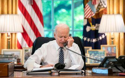 president joe biden talks on the phone