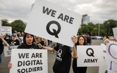 qanon demonstrators holding q army signs
