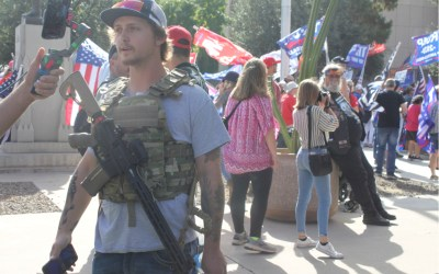 With guns, flags and Bible verses, Trump supporters circle the Arizona Capitol building to protest the results of the 2020 presidential election