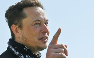 billionaire elon musk holding up the number 1
