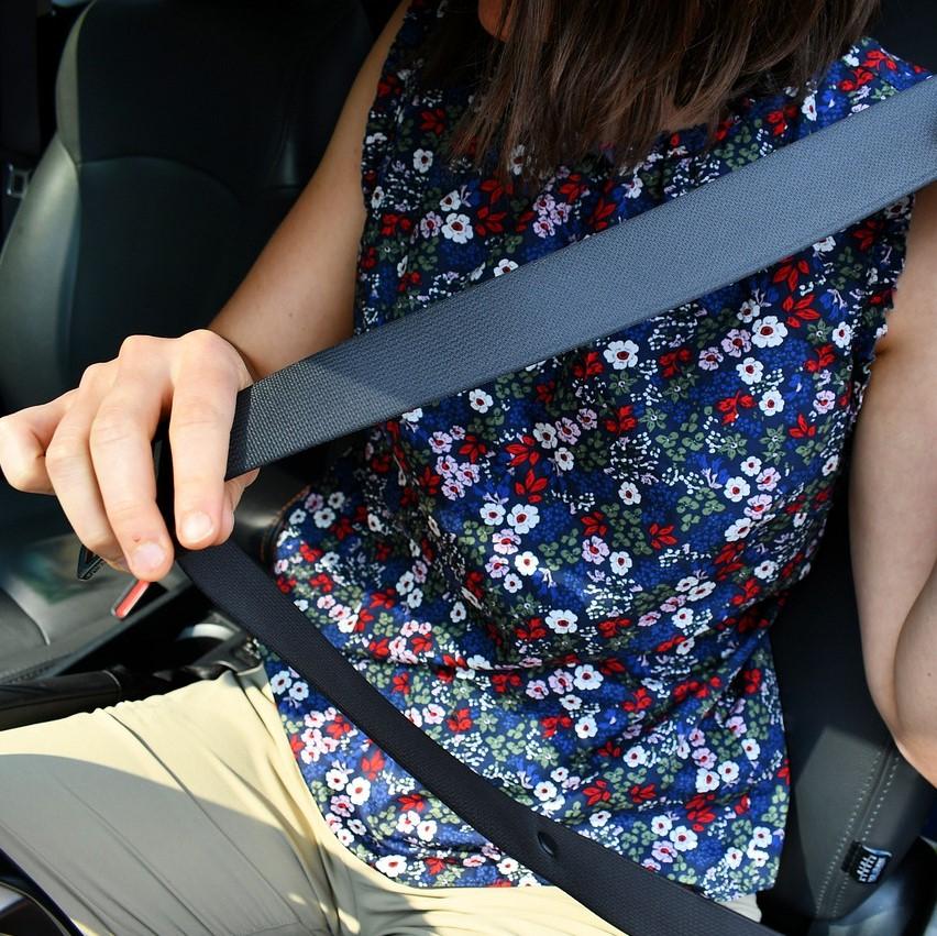 Woman wearing seat belt in car