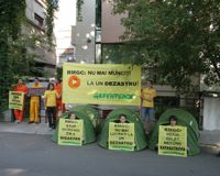 Activists seek to block access to the Rosia Montana Gold Corporation offices in Bucharest. / Credit:Greenpeace