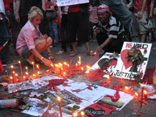 Red shirt protesters light candles at an impromptu shrine in downtown Bangkok. / Credit:Marwaan Macan-Markar/IPS