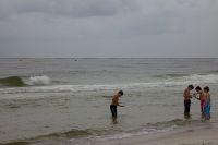 Children playing in the surf at Orange Beach, Alabama. / Credit:Erika Blumenfeld/IPS