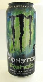 "Black soft drink can with yellow/green cloud, the ""M"" logo like 3 claws in black against the cloud, MONSTER below and underneath it ""Rehab"" in a slimy green"