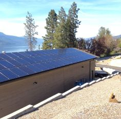60 250w solar panels mounted on a rooftop in McKinley landing BC