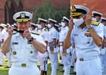 New Delhi, Oct 12 (ANI): Indian Navy Chief Admiral Karambir Singh with US Navy Chief Admiral Michael M. Gilday during inspecting the guard of honour, at South Block, in New Delhi on Tuesday. (ANI Photo/ Shrikant Singh)