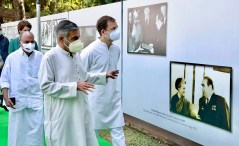 New Delhi, Oct 13 (ANI): Congress leader Rahul Gandhi being briefed about the events during the inauguration of photo exhibition commemorating 50 years of Bangladesh Liberation War, 1971 at party headquarters, in New Delhi on Wednesday. (ANI Photo)