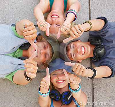 happy-friends-lying-down-thumbs-up-5614422