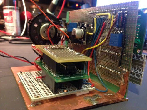 """Side view. Note the whole project was just slapped on top of a piece of old PCB.. It's not even FR4.. just some old stuff. I made some """"mounts"""" out of small copper strap and soldered the protoboard to the bare copper clad board."""