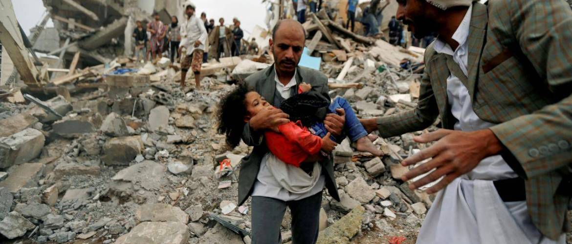 A man carries Buthaina Muhammad Mansour, believed to be four or five, rescued from the site of a Saudi-led air strike that killed eight of her family members in Sanaa, Yemen August 25, 2017. REUTERS/Khaled Abdullah/File Photo