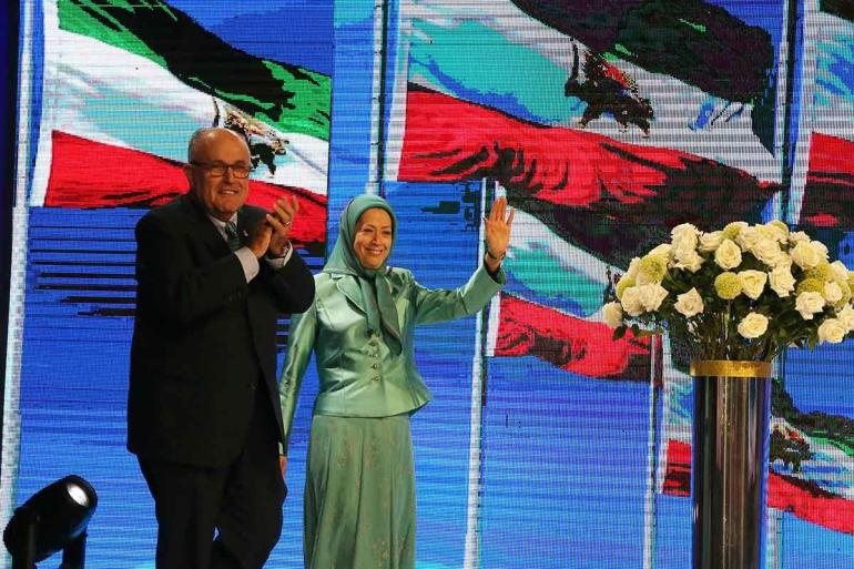 20183202053181906634453_Maryam-Rajavi-and-Mayor-Rudy-Giuliani-wave-at-the-