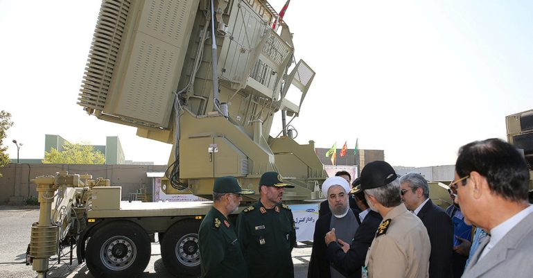 Iran's President Hassan Rouhani and Iranian Defence Minister Hossein Dehghan stand in front of the new air defense missile system Bavar-373, in Tehran