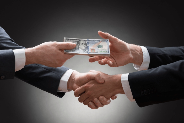 businessmen-shaking-hands-and-exchanging-money