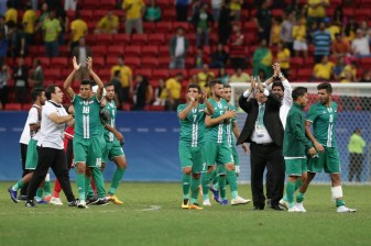 Iraq team celebrate at the end of a group A match of the men's Olympic football tournament between Brazil and Iraq at the National Stadium in Brasilia, Brazil, Sunday, Aug. 7, 2016. The game ended in a 0-0 draw. (AP Photo/Eraldo Peres)