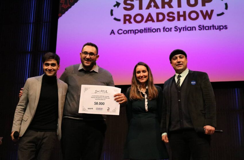 Winning team on stage with certificate