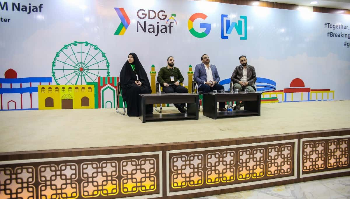 GDG Najaf panel discussion with one women and three men sitting on a stage