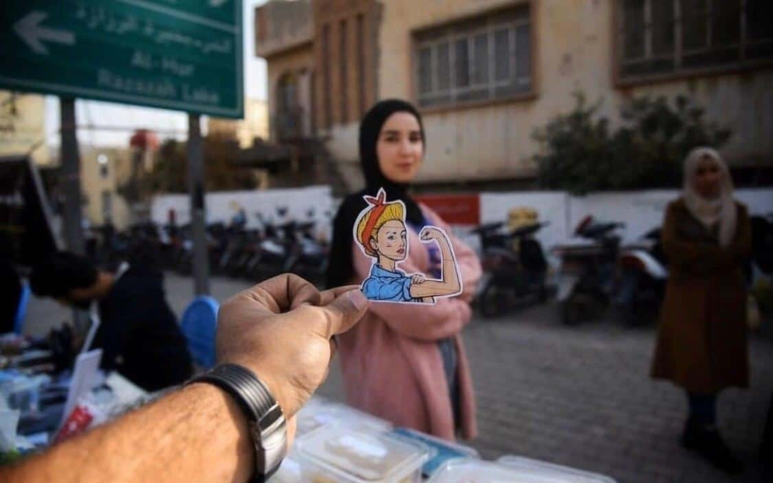 Bursippa businesses in Karbala sticker with woman in background