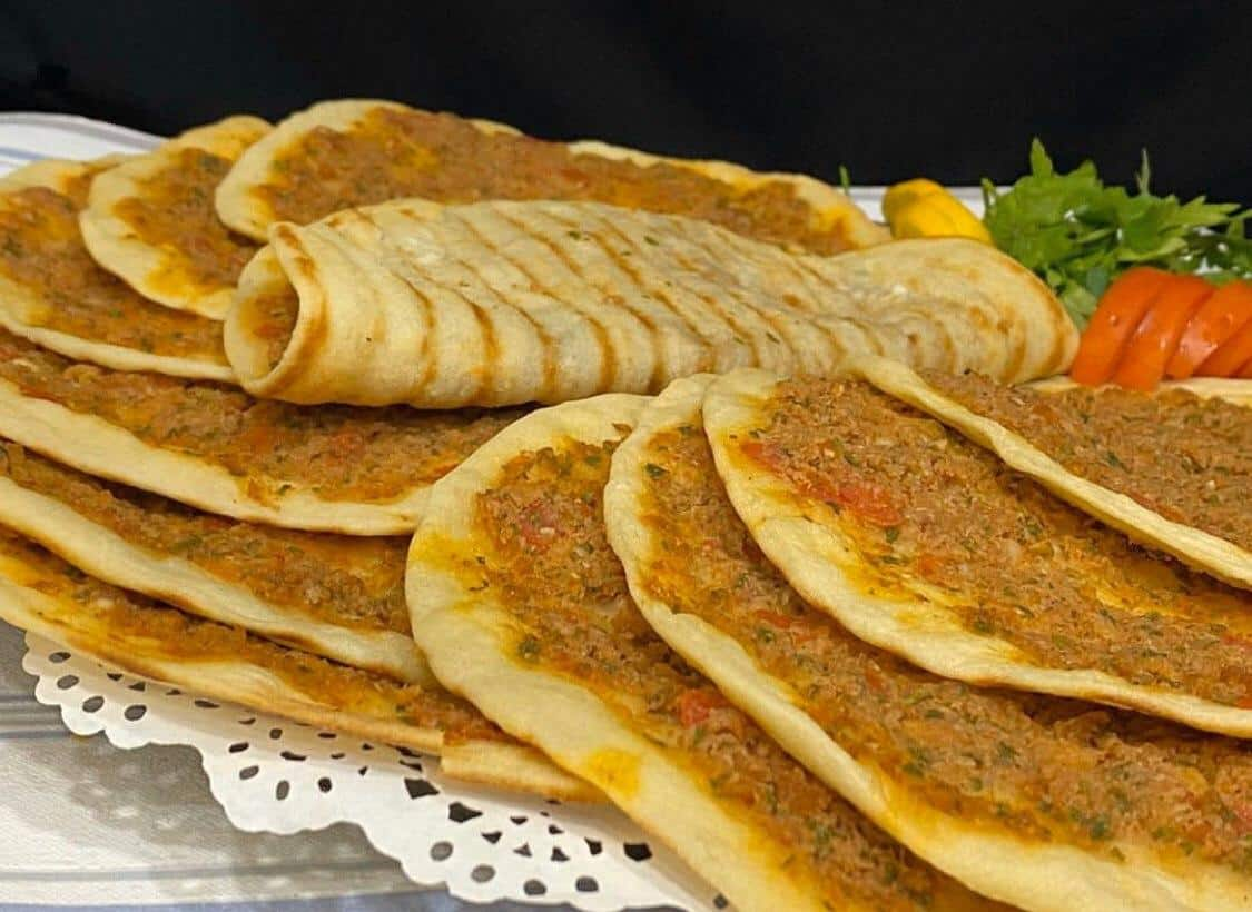 Iraqis Home businesses in Karbala bread with minced meat